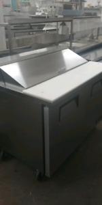 "True 48"" prep fridge, ice machine, prep tables, pizza warmer..."