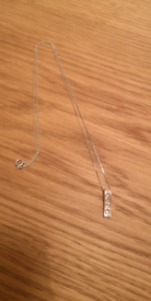 8K marked, white gold necklace.
