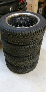 Studded winter tires 215/55R17 on motegi aluminum rims