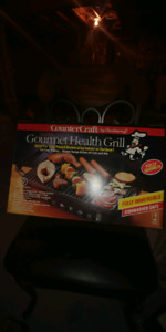 Electric gourmet health grill brand new.