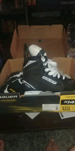 Kids Hockey skates size 10 and youth helmet with cage Brand new!