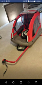Red pull behind bicycle carrier trailer