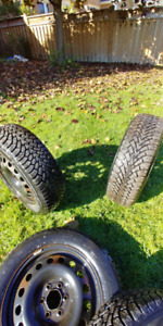 USED GOODYEAR NORDIC WINTER TIRES  225/60R17 WITH RIMS