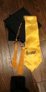 2 graduation caps and honours sash