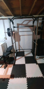Squat rack. Bench. Leg curl + extention + olympic bar + plates
