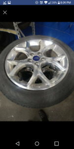 4× 215/50R17 Conti ProContact tires on stock Ford chome alloy