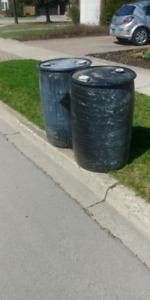 free 60 gallon black rain water barrels 2 on the curb