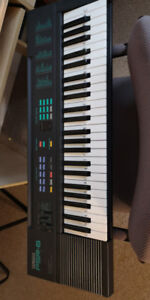 Yamaha PSR-6 Portatone Keyboard / Synthesizer with Several Sheet