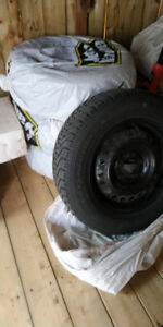 Four winter tires P205/65R15 with Rims