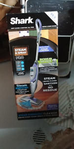Shark Steam Cleaner still in the box ..never used