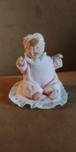 Collectible porcelain musical doll