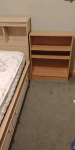 Twin captains bed with head board and bookshelf