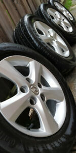 "A set of 4 Clean 5x114.3 15"" Mazda 3 rims with tires"