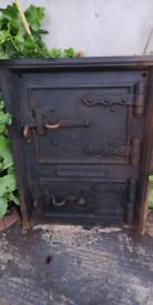 Cast iron stove door
