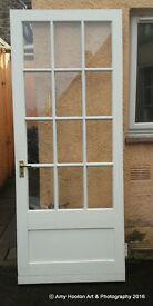 White wooden and glass door