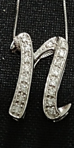 "14K GOLD AND 1 CARAT DIAMONDS LETTER "" N"" WITH 14K GOLD CHAIN"