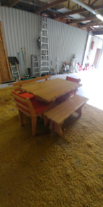 Solid pine table with 2 chairs and 2 benches with 3 cushions.
