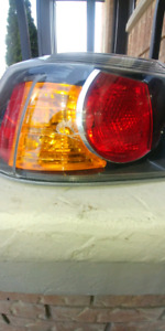 OEM MITSUBISHI LANCER OUTER DRIVER SIDE TAIL LIGHT LENS