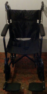 ALMOST NEW TRANSPORT CHAIR