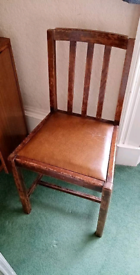 Old wooden chair with original leather cover