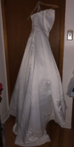 Gorgeous wedding dress new with tags on it