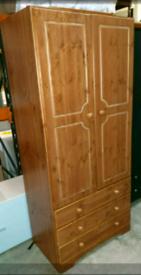 A new stylish pine 2 door 3 drawer wardrobe.