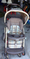Graco stroller with cup holders and storage underneath