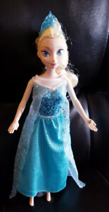 Elsa doll Lights up and Plays music - $15