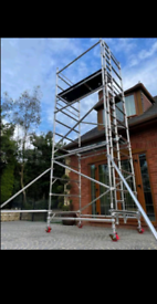 Young man boss scaffolding towers