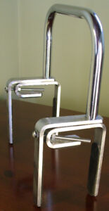Heavy metal with polished chrome finish. Firmly clamps onto the