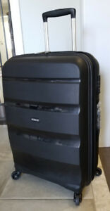 """New, 24"""" American Tourister Spinner Luggage"""
