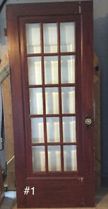 16 Antique Gumwood doors. Circa 1937. Crystal handles