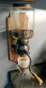 Antique wall mounted coffee grinder