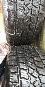 2 Studded NEW winter tires..(235/65/16)