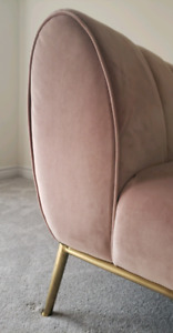 MOVING SALE blush pink velvet sofa with brass accents and art