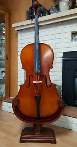 German cello with ornate stand, soft case, DVD and books