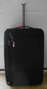 JANSPORT BLACK LUGGAGE BAG
