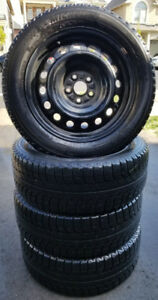 4 Michelin winter tires on steel rims - Size 205/ 55 R 16