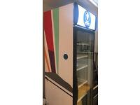 Glass front display fridge with cool graffiti art