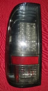 BRAND NEW, Drivers Side ONLY Smoked LED Tail Light.