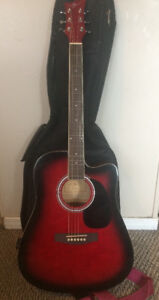 Red Jay acoustic guitar with built in tuner, strap and case
