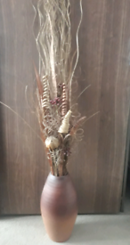 Tall vase with dried reeds