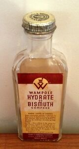 Antique Wampoles Bismuth Hydrate Company Glass Bottle