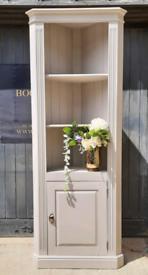 Tall, elegant corner cabinet