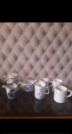 Teapot, milk pot and 4 cups in good condition