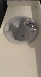 Bathroom counter top with sink and toilet for sale.
