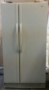 Kenmore side by side fridge works great bisque color