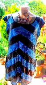 Ladies dress blue sequin dress size 12-14 very bold good quality dress