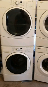 White Kenmore he2 stackable washer and dryer