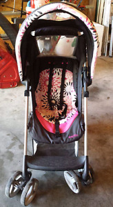 EVENFLO STROLLER WITH PLASTIC COVER